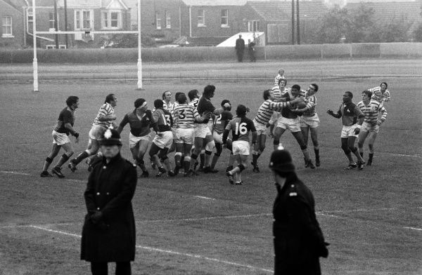 Policemen line the pitch during the South African Barbarians game against Devon in 1979